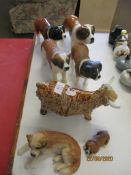 COLLECTION OF DOG AND COW FIGURES