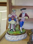 CONTINENTAL PORCELAIN GROUP OF LADY AND GENTLEMAN ON AN OVAL BASE WITH IMPRESSED NUMERALS TO BASE
