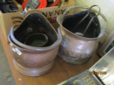 TWO VINTAGE COAL SCUTTLES TOGETHER WITH FIRE IRONS AND A SMALL COPPER SAUCEPAN