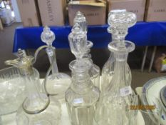 FIVE VARIOUS DECANTERS TOGETHER WITH A SILVER PLATE MOUNTED CLARET JUG, LARGEST APPROX 34CM INC