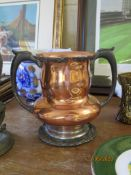 """COPPER AND CAST METAL (POSSIBLY FORMER SILVER PLATE) MOUNTED TROPHY CUP INSCRIBED """"BRYN MAWR 1904"""