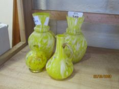 GROUP OF COLOURED YELLOW GLASS WITH GILT DECORATION INCLUDING TWO VASES, TWO SMALL EWERS