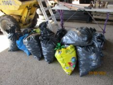 ELEVEN VARIOUS SACKS CONTAINING COAL