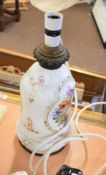 Ceramic lamp base with a floral design to front and verso
