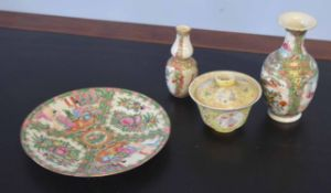 Group of Cantonese wares decorated in famille rose style, comprising a plate, two vases and a bowl