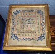 Victorian sampler, wool stitched on gauze, square frame with capital letters, the centre