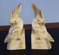 "Pair of alabaster models of parrots, one inscribed ""Recordo de Pisa"" (2)"