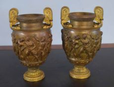 Pair of parcel gilded bronze patinated two-handled vases, bodies each embossed with classical