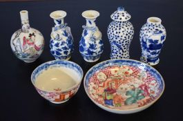 Chinese porcelain tea bowl and saucer decorated with Chinese figures in a landscape, together with a