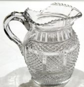 Early 19th century cut glass water jug, probably Irish, circa 1810, the glass with hobnail cut above