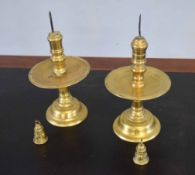 Pair of heavy brass altar candlesticks, each with large central drip trays, together with