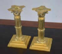 Pair of late 19th/early 20th century brass candlesticks with Corinthian column stems and stepped