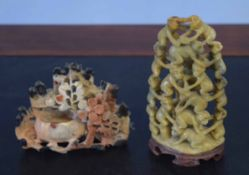 Two soapstone carvings, one of monkeys, the other of flowers (2), largest 13cm high