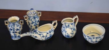 Group of Continental porcelain decorated in Meissen style with blue and white designs, all pieces