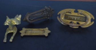 Box containing various vintage brass and cast metal door knockers, letter flap etc