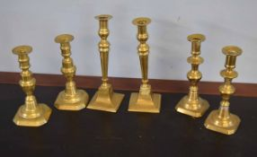 Three pairs of Victorian and later brass candlesticks, largest 26cm high