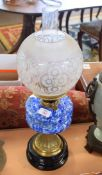 Oil lamp glass patterned shade and blue glass reservoir on brass stand