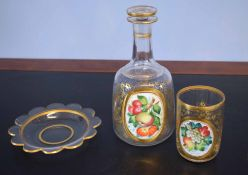 Decanter, the front decorated with a fruit design, together with a further beaker on stand decorated