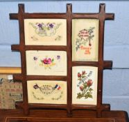 Early 20th century set of framed silk and other greetings cards, overall 33cm wide
