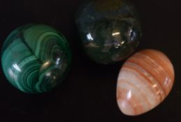 Box containing three large marbles