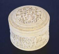 Ivory circular box and cover carved in relief with figures in a landscape, 11cm diam