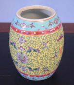 Chinese porcelain barrel shaped jar, (cover lacking), with a scroll design on yellow ground, 16cm
