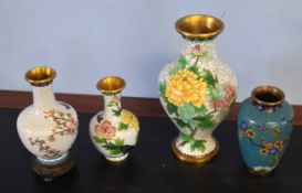 Group of cloisonne vases including large vase decorated with flowers, two smaller vases with similar