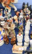Group of figures, some intended as small liqueur containers including Rutherford's Scotch Whisky, (