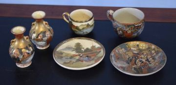 Satsuma cup and saucer, further Satsuma decorated with sages and a pair of vases with similar
