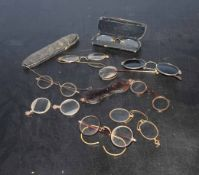 Box containing eight pairs of antique spectacles (some in cases)