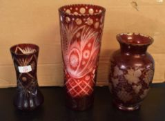 Two Bohemian style vases, one with a cut glass design on puce ground, the other with a leaf and