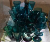 Quantity of green glass wares, late 19th/early 20th century, including a carafe with stopper,
