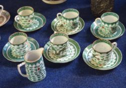 Part Chinese porcelain tea set decorated with a famille vert design, comprising six cups and saucers
