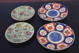 Pair of Cantonese plates decorated with famille rose on a green background (4)