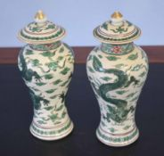 Pair of Oriental porcelain vases decorated in a famille vert palette with dragons amongst clouds,