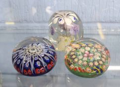 Group of three paperweights