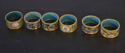 Collection of six champleve enamel decorated napkin rings