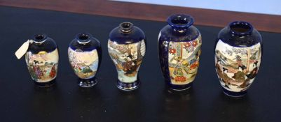 Group of five Japanese Satsuma ware vases all decorated in typical fashion