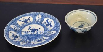 Chinese porcelain bowl decorated with warriors and immortals in various pursuits, the centre