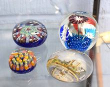 Group of four paperweights