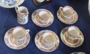 Part Chinese porcelain tea set, comprising five cups and saucers decorated in famille rose designs