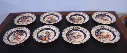 Group of eight Japanese porcelain Imari style plates with pierced rims (8)