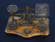 Set of brass postal scales and weights, 19cm wide