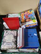Tray containing modern jigsaw puzzles, hardback books etc