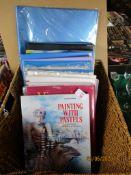 Basket containing various books, folders etc