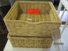 Two modern wicker storage baskets