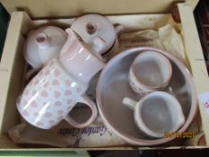 Tray containing pink and white Denby ware