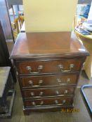 Mahogany veneered four drawer chest