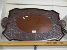 HEAVILY CARVED EARLY 20TH CENTURY TEA TRAY, POSSIBLY OF INDIAN OR BURMESE ORIGIN, LENGTH APPROX