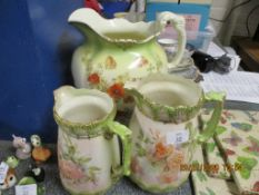 THREE FLORAL JUGS INCLUDING LARGE WATER JUG BY MAPLE, LARGEST APPROX 29CM